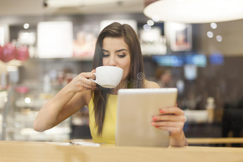 Woman with tablet at cafe