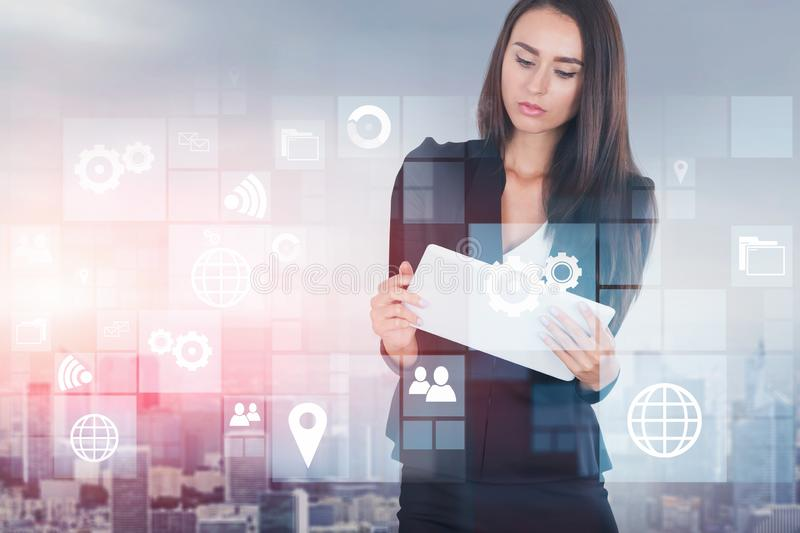 Woman with tablet in city, business interface royalty free stock photo