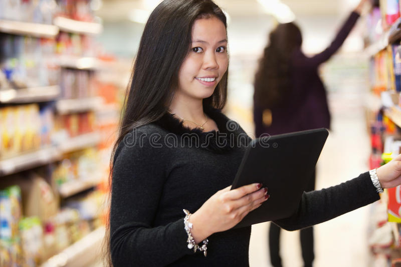 Download Woman With Tablet Computer Shopping List Stock Image - Image: 19472591