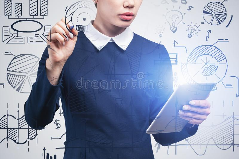 Woman with tablet drawing business plan sketch stock image