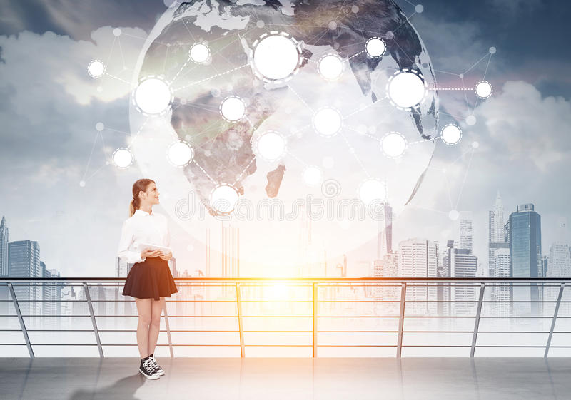 Woman with tablet, globe and network royalty free stock photo