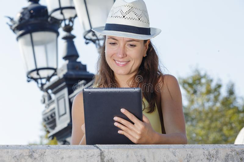 Woman with tablet and hat during holidays royalty free stock photo