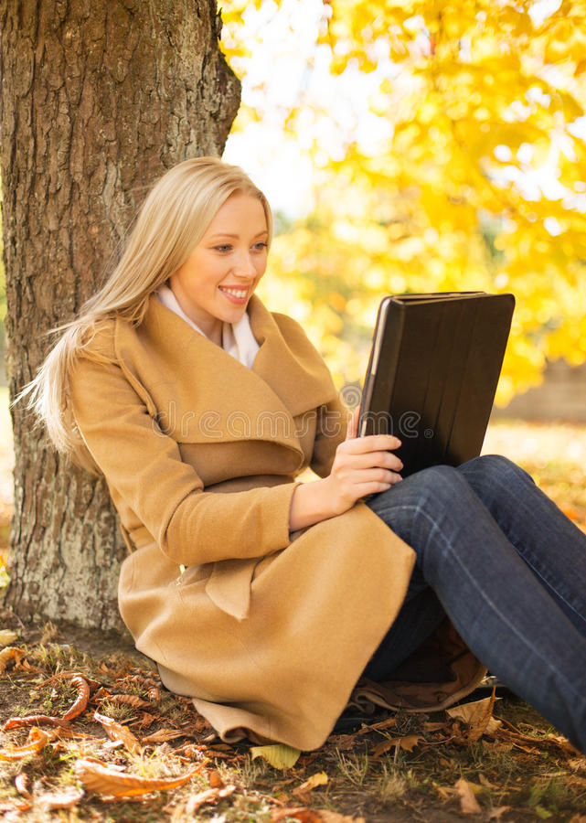 Download Woman With Tablet Pc In Autumn Park Stock Image - Image of outdoors, female: 34774791