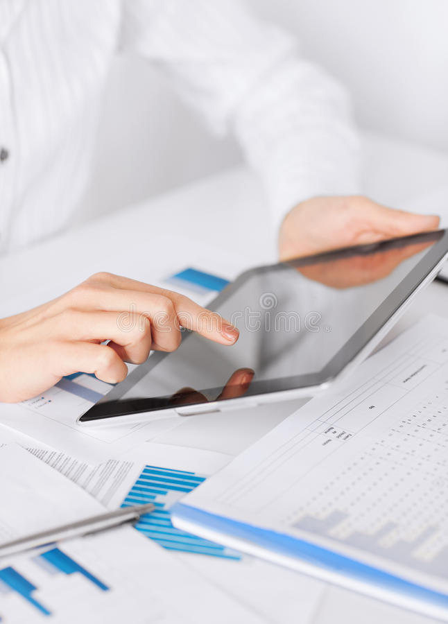 Woman with tablet pc and chart papers stock images