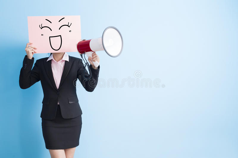 Woman take billboard and microphone. Business woman take happy billboard and microphone ,isolated blue background stock images
