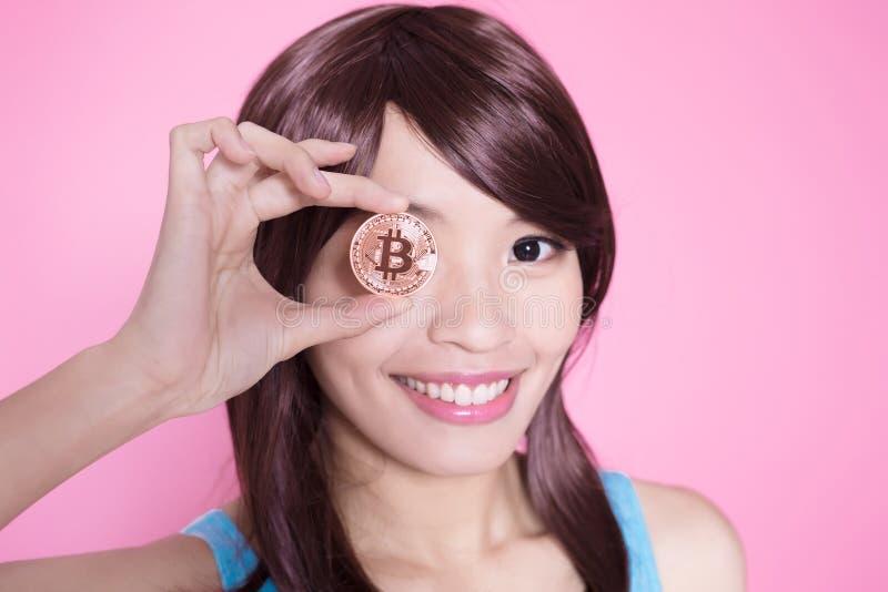 Woman take bitcoin royalty free stock photos