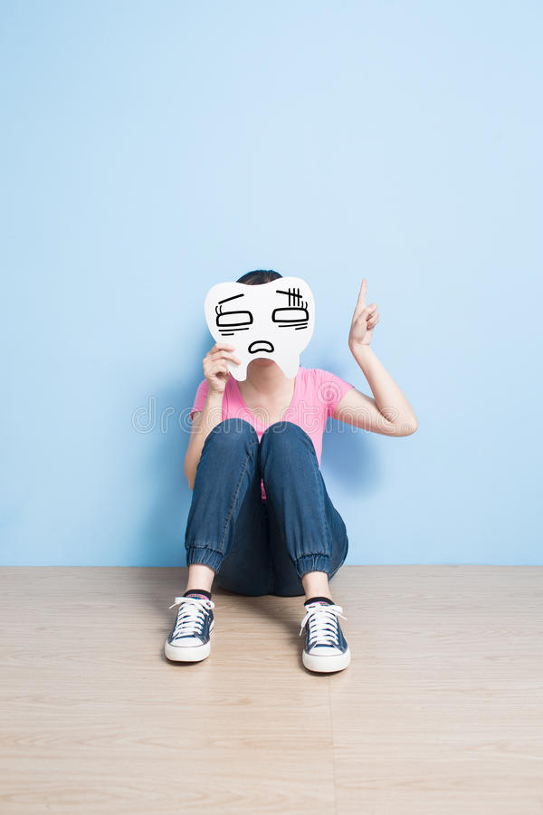 Woman take confuse tooth. And show something on the floor royalty free stock photos