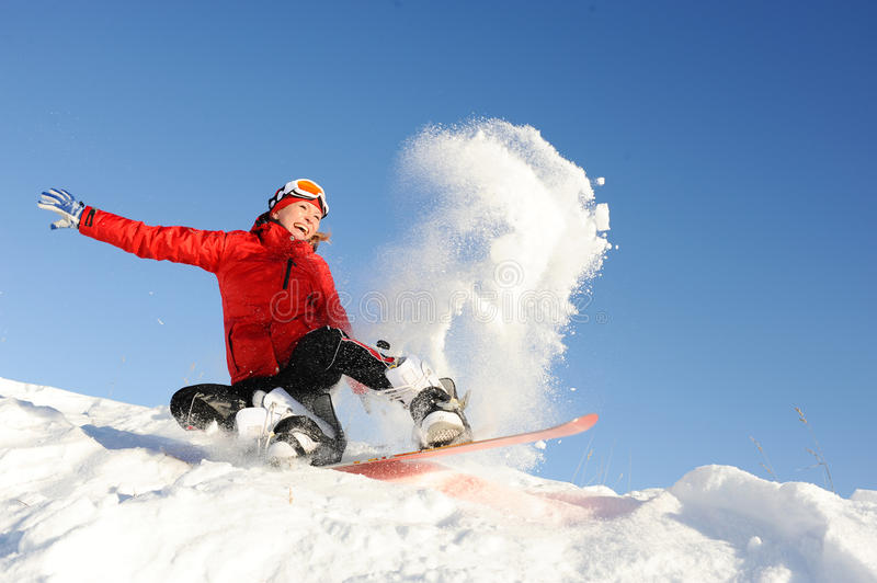Woman take fun on the snowboard. Young woman take fun on the snowboard royalty free stock photos