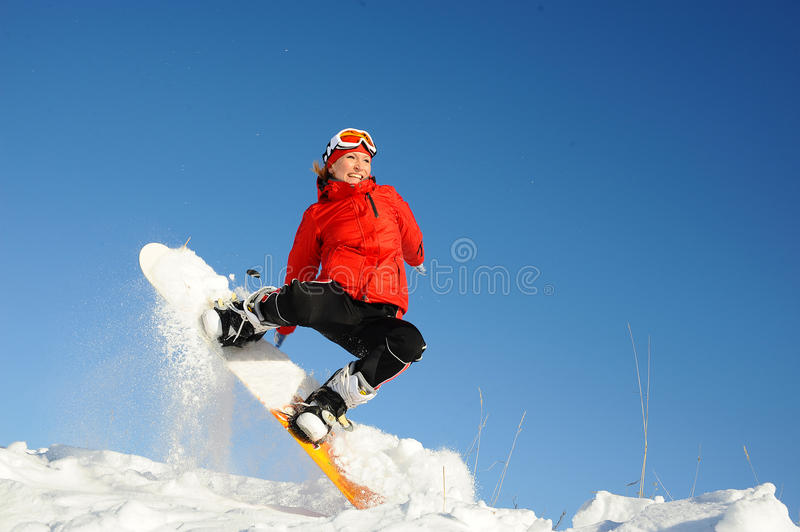 Woman take fun on the snowboard. Young woman take fun on the snowboard stock photo