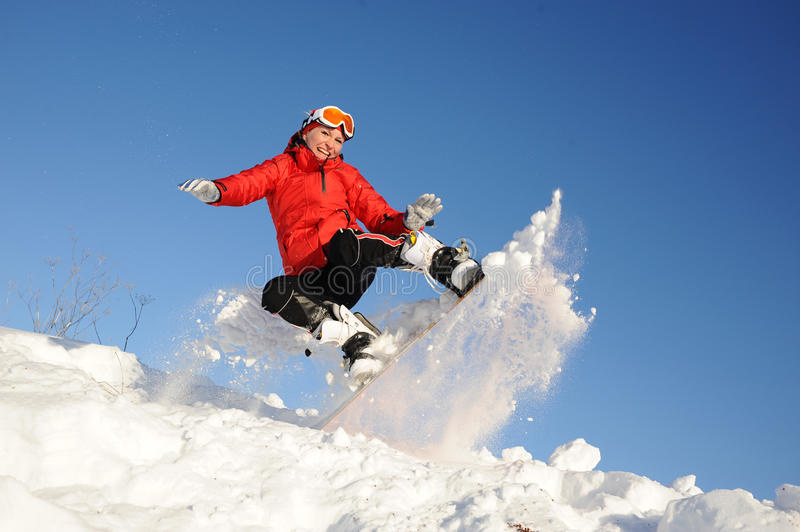 Woman take fun on the snowboard. Young woman take fun on the snowboard stock photography