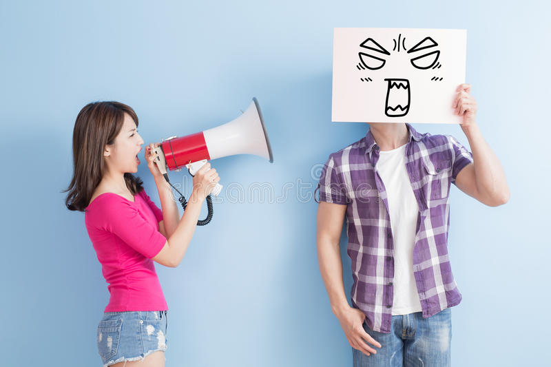 Woman take the microphone. Shout to men take angrily billboard isolated on blue background stock photography