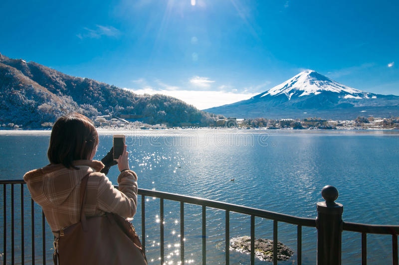 Woman take photo on mountain Fuji. stock images
