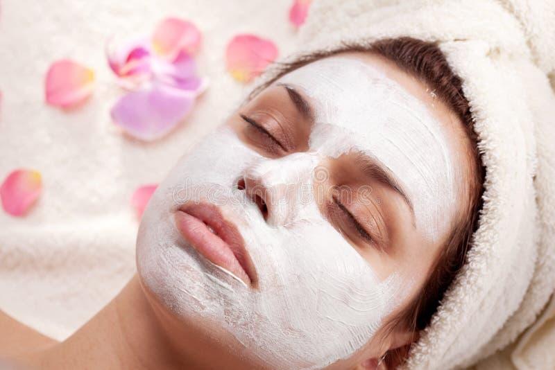 Woman takes cosmetics mask stock photo