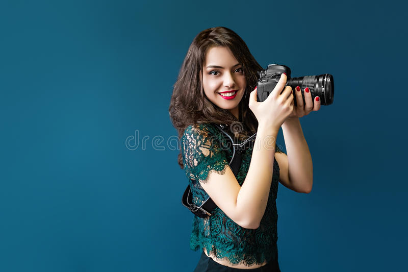 Woman takes images holding photographic camera stock photo