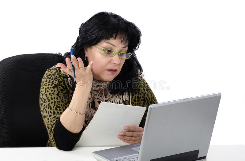 Woman takes online English conversation lesson. Mature woman takes online free English conversation lesson for beginning royalty free stock images