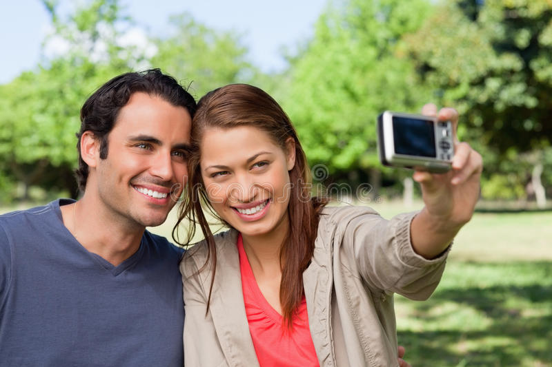 Woman Takes A Picture Of Her Friend And Herself With A Camera Stock Image