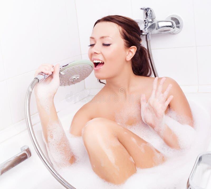 Woman taking a bath stock photo