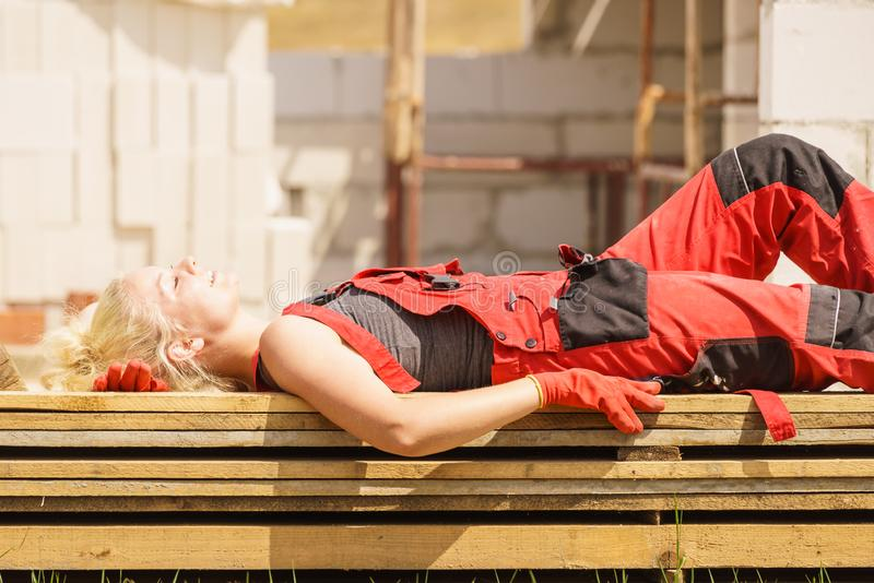 Woman taking break on construction site royalty free stock photo