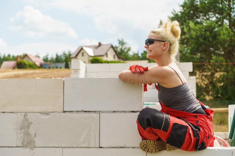 Woman taking break on construction site stock photo