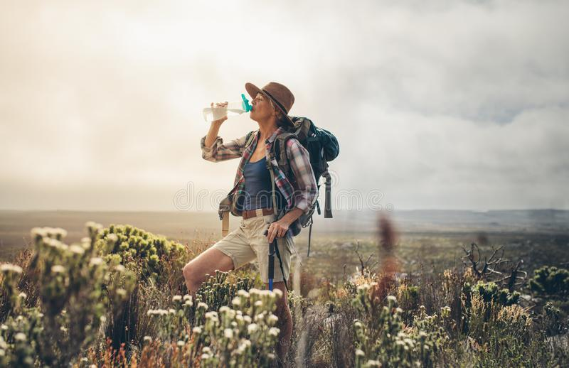 Woman taking a break during her trek stock image