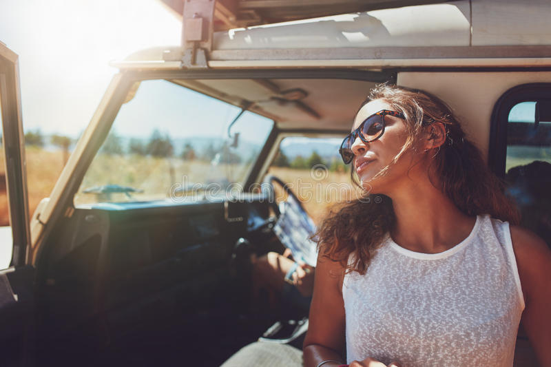 Woman taking a break from the road trip royalty free stock images