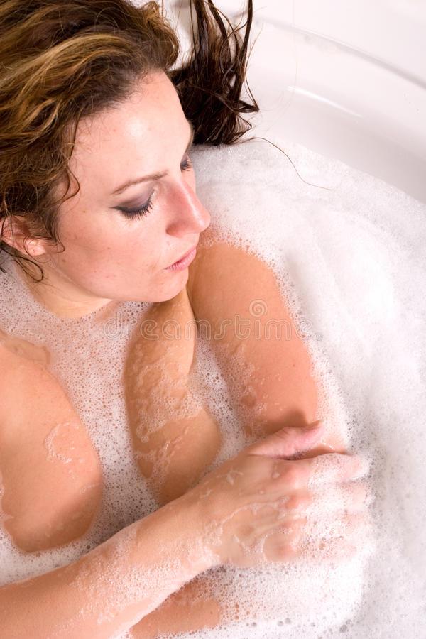 Download Woman taking bubble bath stock photo. Image of brunette - 14427058