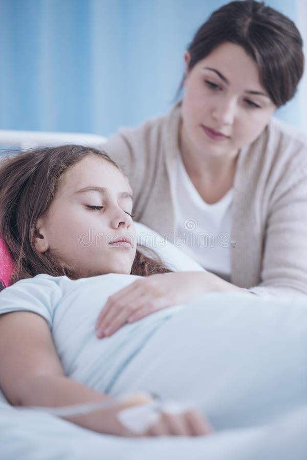 Woman taking care of sick younger sister during stay in a private clinic royalty free stock photo