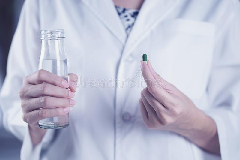 Woman are taking and eating medicines and vitamins for help sick and healthy stock image