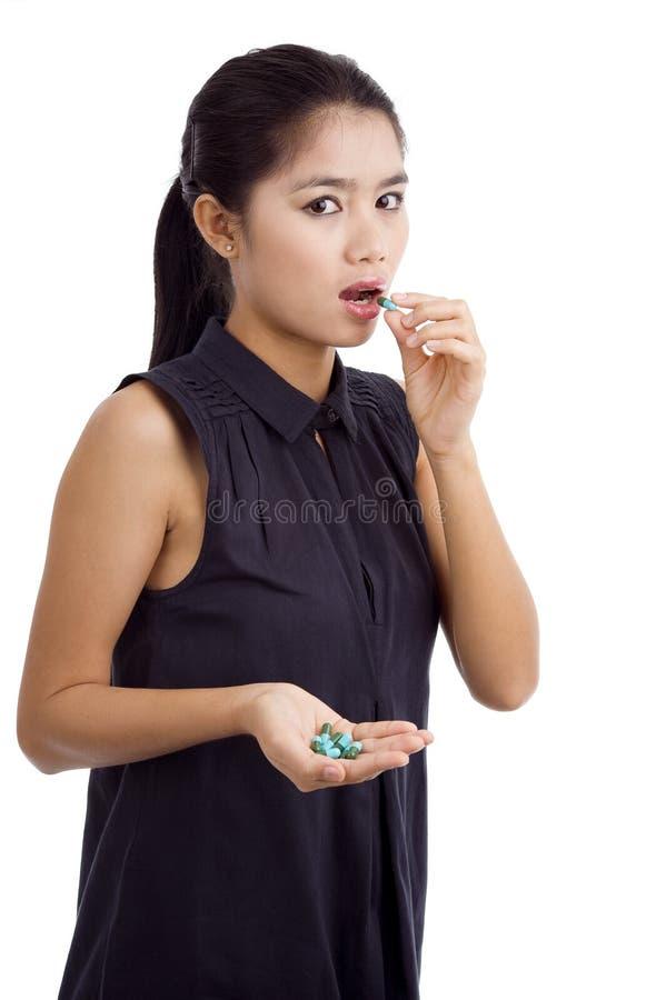 Woman taking medicine royalty free stock photo