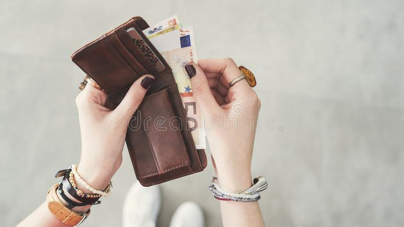 Woman taking out euro money from her pocket wallet top view royalty free stock photos