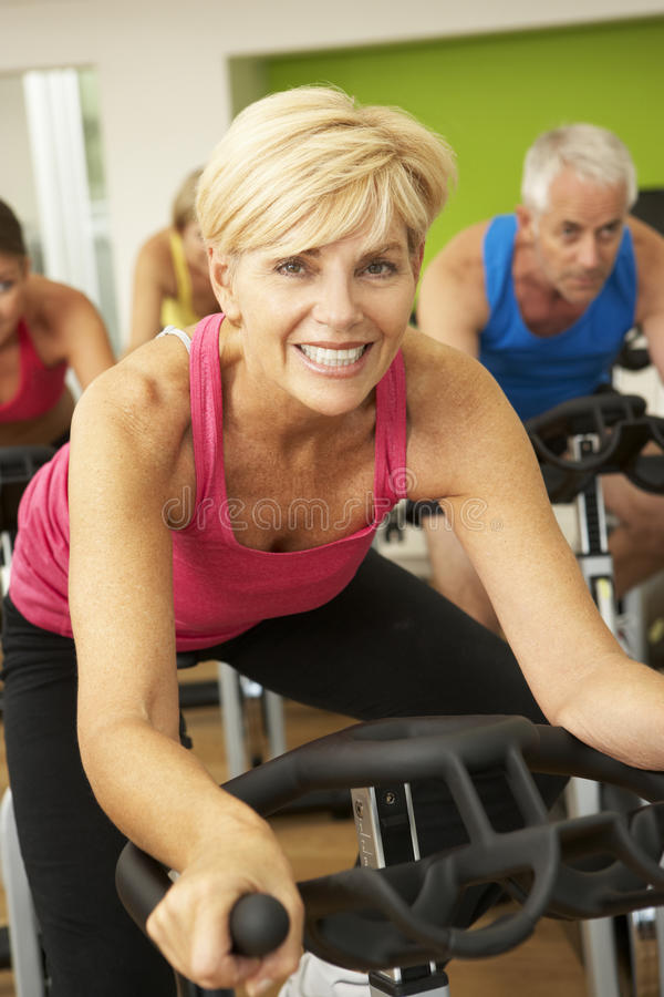 Download Woman Taking Part In Spinning Class In Gym Stock Photo - Image: 55896150