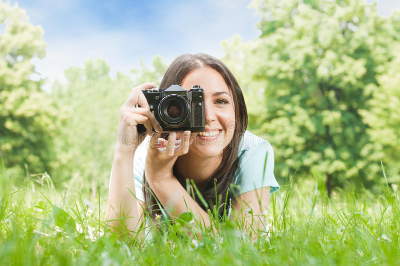 Woman taking photo. With old fashioned camera stock images