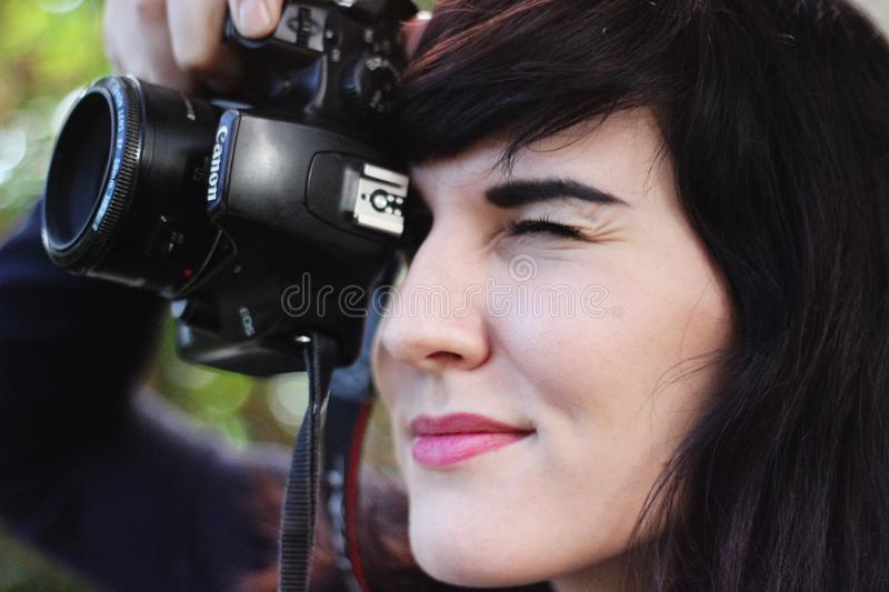 Woman Taking a Photo With Canon Dslr Camera stock photography