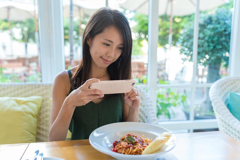 Woman taking photo on her dish stock photography