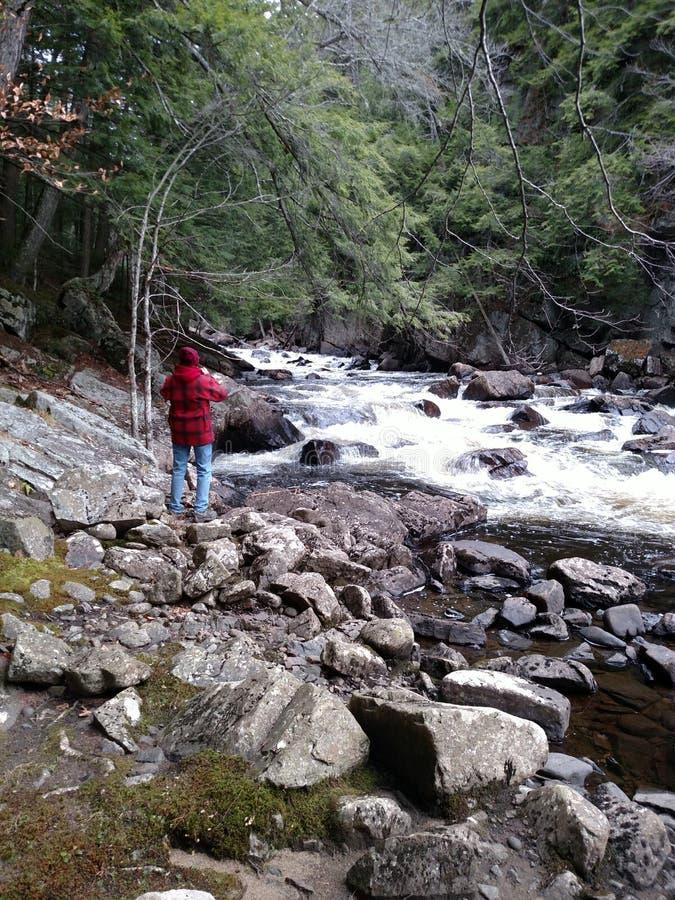 Woman taking photo of mountain river royalty free stock photos