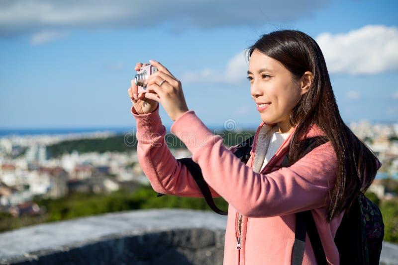 Woman taking photo stock image