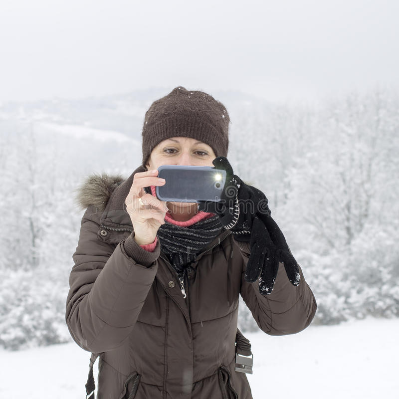 Woman taking photo with smartphone stock photos