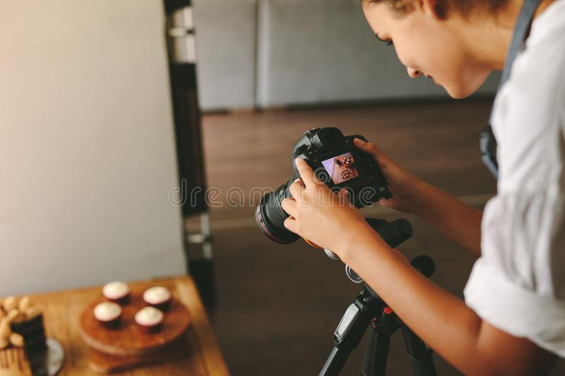 Woman taking photos for her food blog stock images