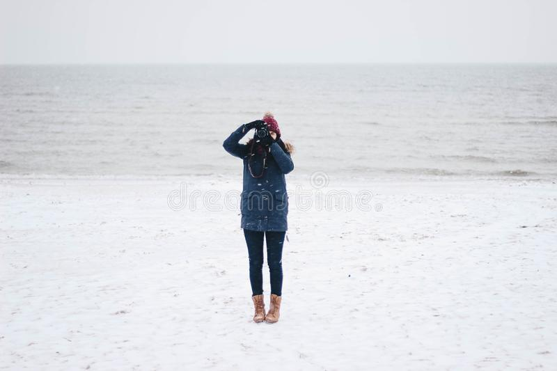 Woman Taking Picture on the Beach View stock photos