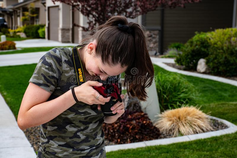Woman Taking a Picture of Floor Using Nikon Camera royalty free stock photo
