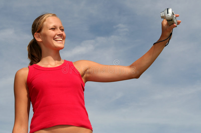 Download Woman Taking A Picture Of Herself Stock Photo - Image of smiling, copy: 1033574