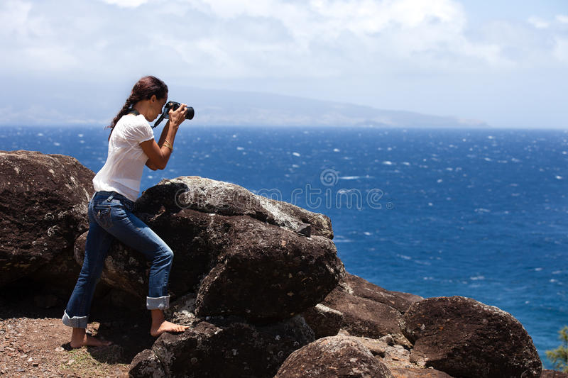 Woman taking a picturein Maaui, Hawaii stock photo
