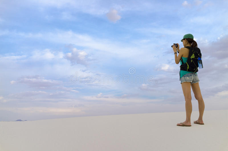 Woman Taking Pictures - White Sands New Mexico. Tourist girl taking pictures at White Sands New Mexico royalty free stock photo