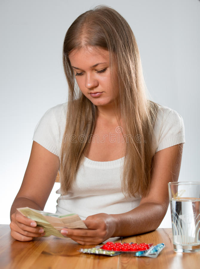 Woman taking pills royalty free stock photos