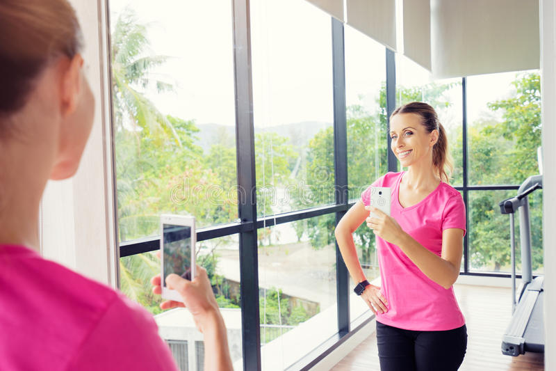 Download Woman taking selfie in gym stock image. Image of photographing - 91446237