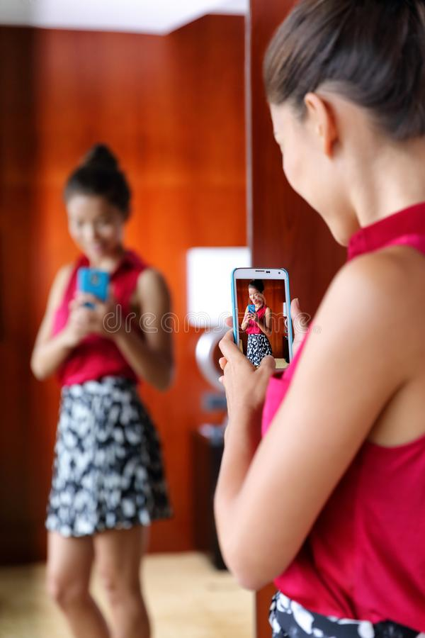 Woman taking selfie in home mirror stock images