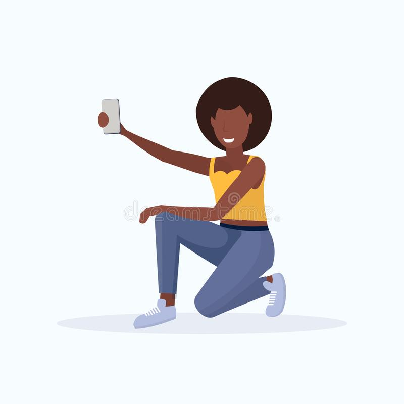 Woman taking selfie photo on smartphone camera african american female cartoon character sitting and posing on white. Background flat full length vector stock illustration