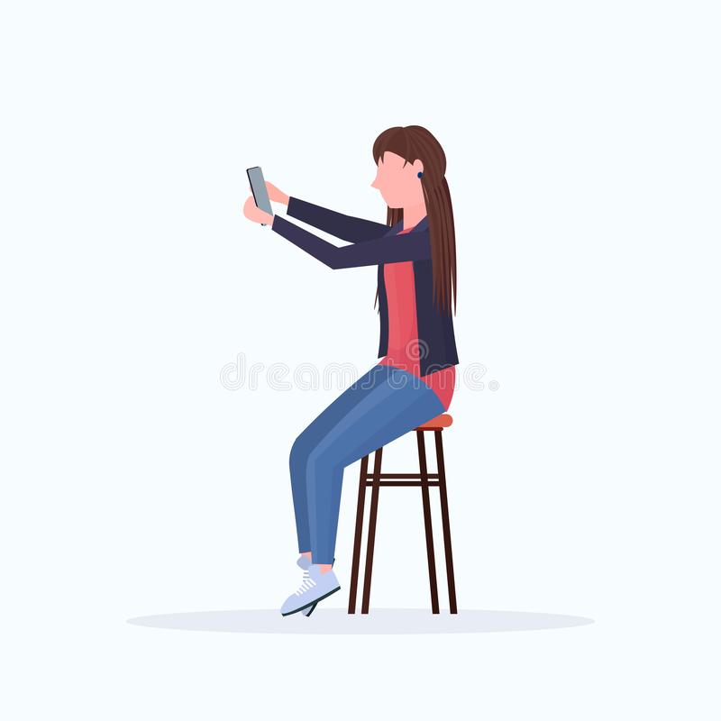 Woman taking selfie photo on smartphone camera blonde female cartoon character sitting on chair posing on white. Background flat full length vector illustration royalty free illustration