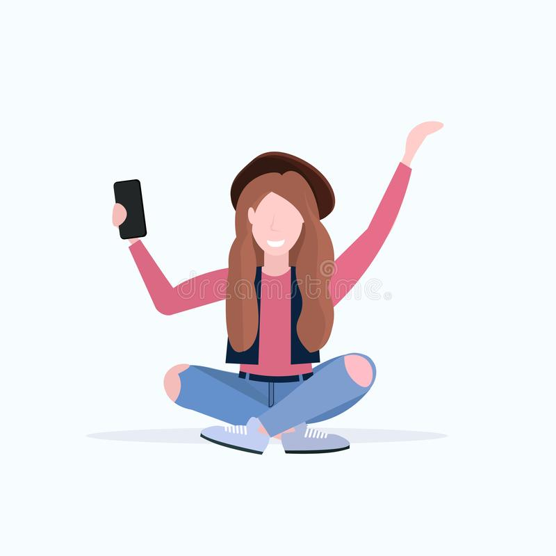 Woman taking selfie photo on smartphone camera casual female cartoon character sitting girl in hat posing on white. Background flat full length vector royalty free illustration