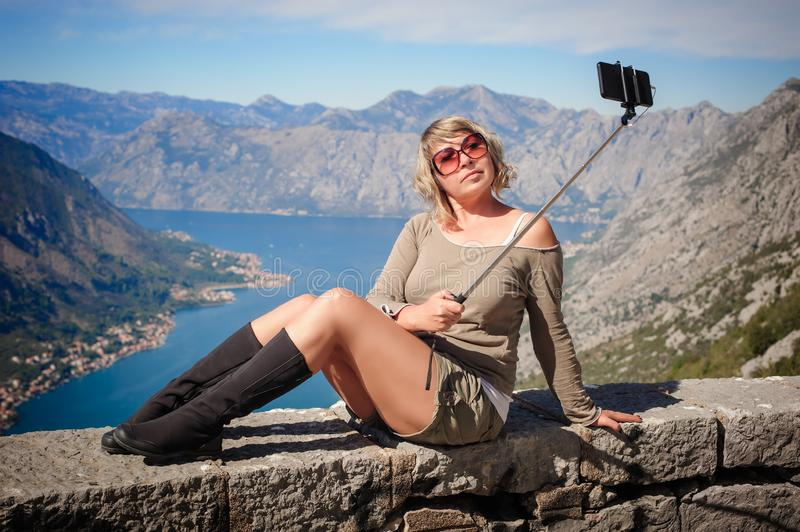 Woman taking selfie picture on landscape background using photo stock photos
